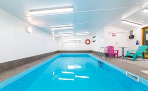 Indoor heated swimming pool with two private swim sessions a day