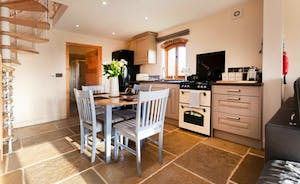 A bright and modern country style kitchen with a dining table for 4