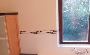 Cloakroom (downstairs with toilet, basin) off the utility room.
