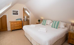 Foxcombe - Light and spacious, Bedroom 6 is on the first floor; have the beds as twins or a superking. There's a generously sized an en suite shower room