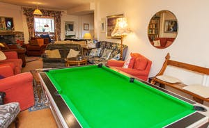Pool table and large L shaped lounge