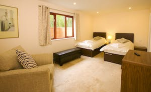 Cockercombe - Bedroom 2 is a ground floor room with an en suite shower room