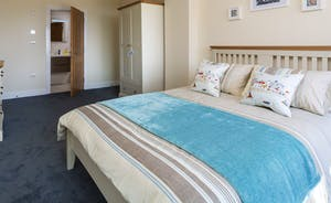 Bedroom 3 with king sized bed and en suite