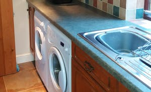 Utility room with washing machine, sink, tumble dryer etc