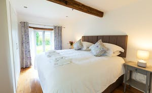 Pippinsands, Stonehayes Farm - On the ground floor, Bedroom 6 has French doors that open onto the garden