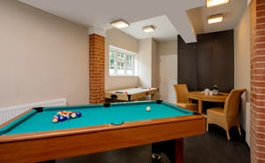 Garden Court - Pool and air hockey in the games room