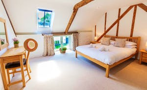 Whinchat Barns - Wagtail Corner, Bedroom 1: A restful room with original rustic features