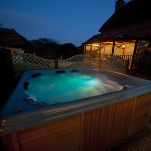 Sleeps 12 with hot tub.thumb