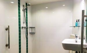 Ground floor bedroom's accessible en suite shower room