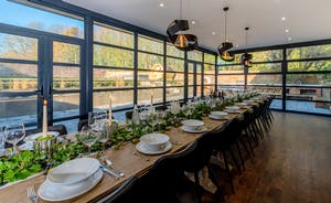Hesdin Hall - The glass walled dining room overlooks the walled garden