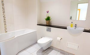 Dippers Rest, Stonehayes Farm - Bedroom 1 has an en suite bathroom with a P-bath and an overhead shower