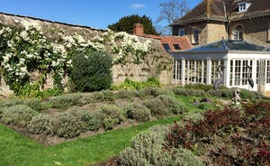 Enclosed garden with orangery and house behind