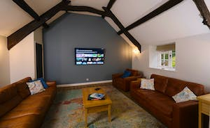 Large lounge with 65 inch TV