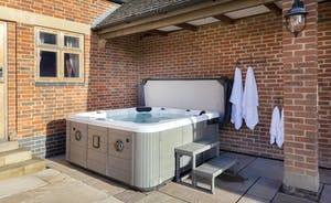 Just outside of Bumblebee Barn is a jubbly bubbly hot tub with room for 6
