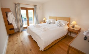 Berry House - Light and airy, Bedroom 7 is on the ground floor of the pool building and has en suite shower room