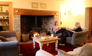 Enjoying a cup of tea by the open fire in the main sitting room!