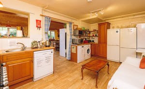Both kitchens have Range cookers, and include; 4 large fridge freezers, washing machine, tumble drier, 2 microwaves and a slow cooker.