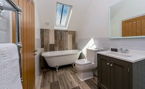 Croftview - Bedroom 13 (Stag) has an en suite bathroom with a free standing bath and walk-in shower