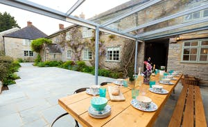 Frog Street: The patio and covered dining area at the front of the house