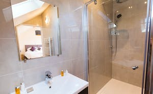 Shires - Bedroom 6 has a sleek and stylish en suite shower room