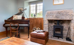 Baby Grand Piano, Italian leather sofas, Log burner and a wonderful literary collection on which you can feast over the weekend!