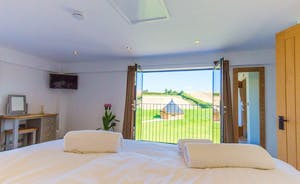 The Granary - Bedroom 2: look out of the Juliette balcony for far reaching views across the beautiful Somerset countryside
