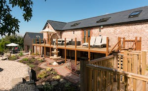 Foxhill Lodge - Put your feet up on the loungers up on the veranda - views and sunshine
