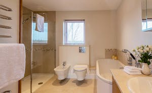 Herons Bank - The main bathroom has a walk-in shower and a big bath tub