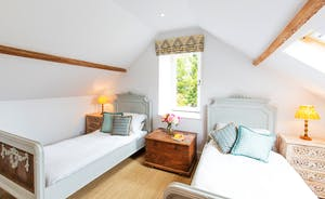 House On The Hill - Bedroom 7: antique French beds are painted in a Farrow & Ball heritage shade
