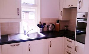 First Floor Apartment Compact but fully stocked Kitchen with Dishwasher, fridge freezer, oven and food processor