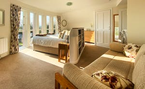 The Cottage Beyond: The Sofa in Bedroom 2 can be used as two extra single beds, so it makes an excellent room for families.