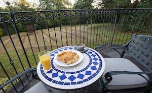 Sandfield House - Bedroom 2: Enjoy breakfast on the balcony overlooking the garden