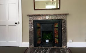 Some of the bedrooms offer feature fireplaces