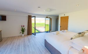 The Granary - Bedroom 2 is on the first floor and has an en suite shower room; the beds can be arranged as a superking or twins.