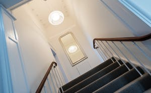 Pitmaston House - An elegant staircase takes you to the master bedroom