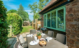 Pretty Garden and Hot Tub on Courtyard  at Cornflower Cottage