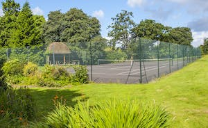 Bossington Hall - A hardstanding tennis court with a wonderful thatched pavillion; the perfect place for refreshments