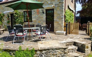 Kingfisher Cottage from the garden  -  decking and patio with variety of seating