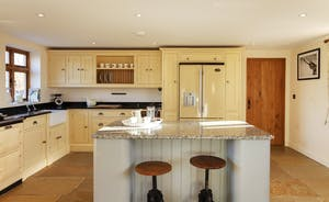 The kitchen is stylish, spacious and well equipped