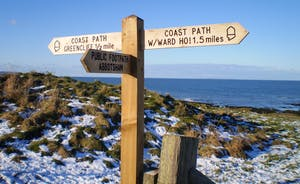 Signpost in the snow Abbotsham Cliffs