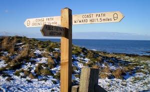 Signpost in the snow Abbotsham Cliffs