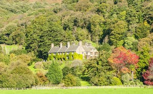 Bossington Hall - A backdrop of steeply wooded hills and the wild heaths of Exmoor National Park