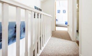 Upstairs hallway looking towards the single bedroom