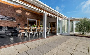 Herons Bank - Huge bi-fold doors open from the orangery onto the patio