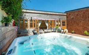 Relax In The Hot Tub day or night at Lavender Barn