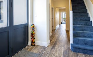 Entrance hall leading to two double bedrooms and access to garden