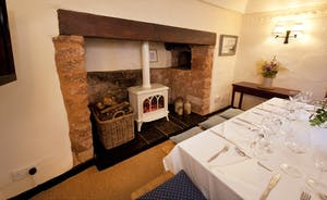 Halse Water House - A centuries old inglenook fireplace in the dining room - with an electric 'woodburner' effect stove for added warmth at the chillier times of the year