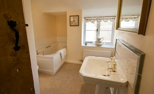 Halse Water House - The pretty shared bathroom for Bedrooms 2 and 3 also has a separate shower cubicle.