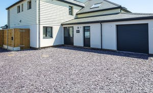 Driveway with ample parking for 2/3 vehicles