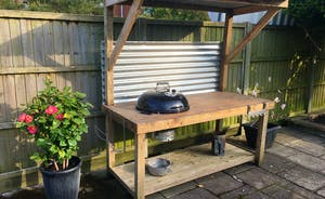 Covered Weber Charcoal BBQ